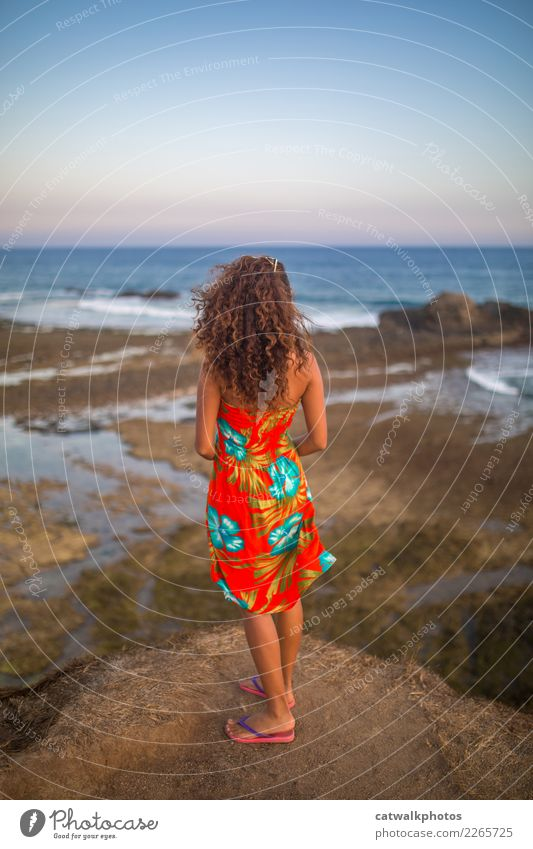 Girl with long curly hair looking from the cliff into the ocean Lifestyle Elegant Vacation & Travel Tourism Adventure Freedom Summer Summer vacation Ocean