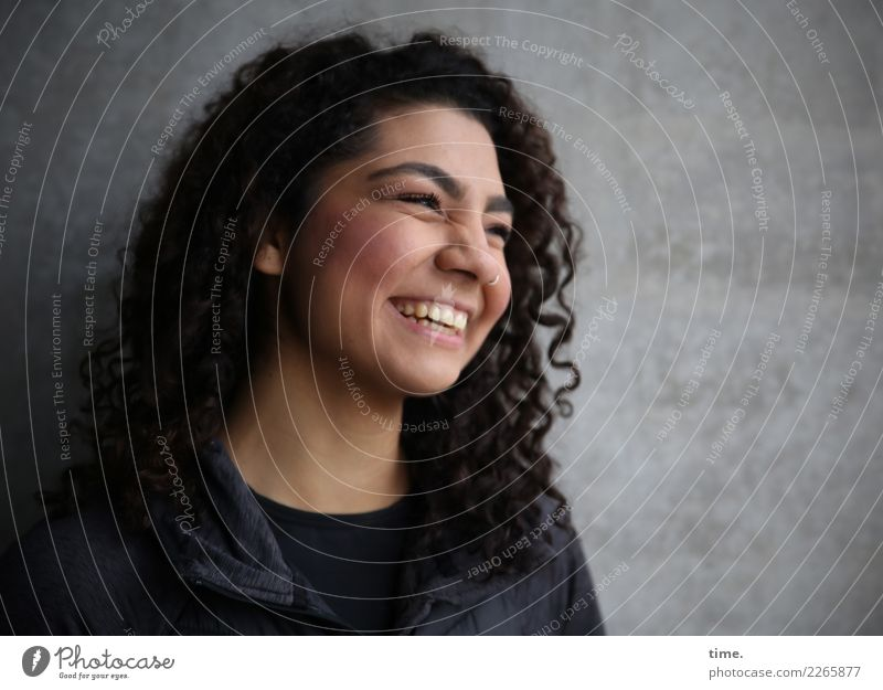 Nikoliya Feminine Woman Adults 1 Human being Wall (barrier) Wall (building) T-shirt Jacket Piercing Brunette Long-haired Curl Relaxation Laughter Looking