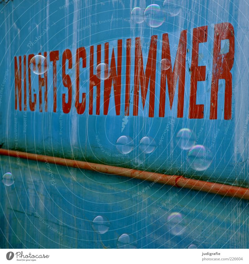 non-swimmer Swimming pool Sign Characters Blue Red Joy Non-swimmer Soap bubble Hover Colour photo Exterior shot Deserted Day Reflection Wall (building)