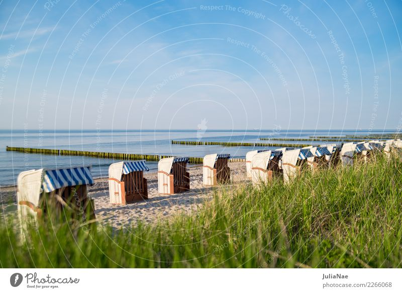 Beach chairs at the Baltic Sea beach Relaxation Calm Vacation & Travel Far-off places Ocean Sand Water Sky Coast Lake Friendliness Bright Blue Loneliness