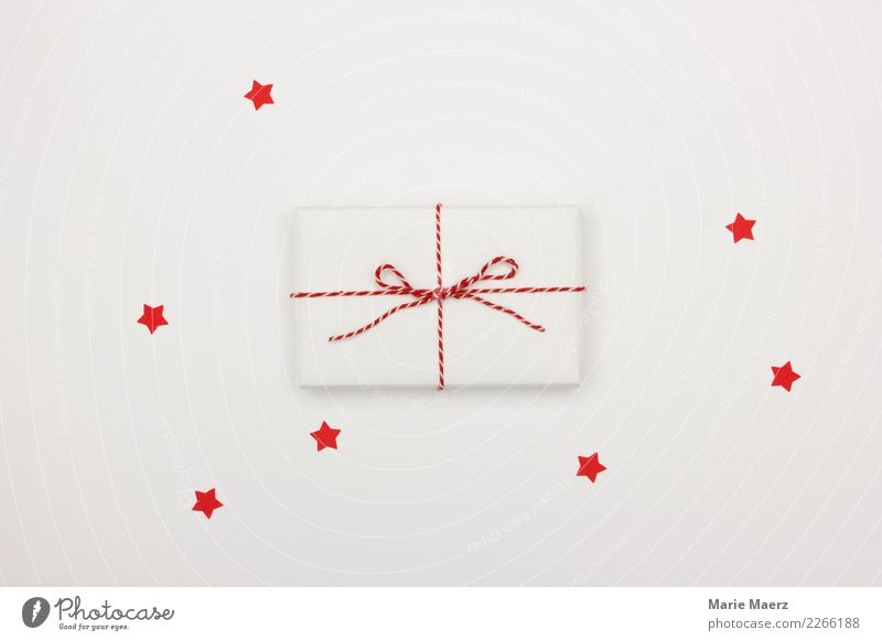 Small white gift with red bow and red stars Christmas & Advent Feasts & Celebrations Esthetic Simple Fantastic Curiosity White Joy Anticipation Design