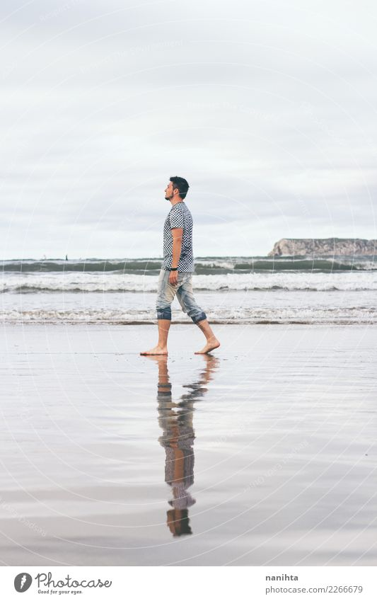Man walking along the beach Human being Nature Vacation & Travel Beautiful Water Landscape Relaxation Loneliness Clouds Beach Adults Lifestyle Environment