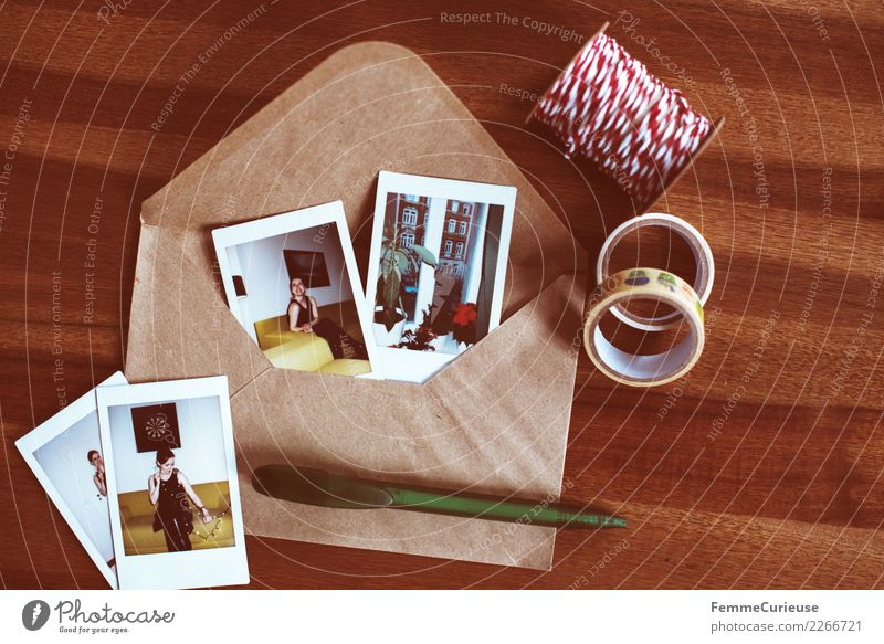 Instant pictures and envelope on table (02) Feminine Young woman Youth (Young adults) Woman Adults 1 Human being 18 - 30 years Communicate Memory Salutation