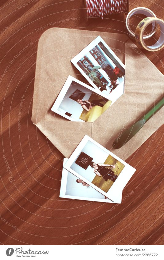 Instant pictures and envelope on table (01) Lifestyle Feminine Young woman Youth (Young adults) Woman Adults Human being 18 - 30 years Communicate