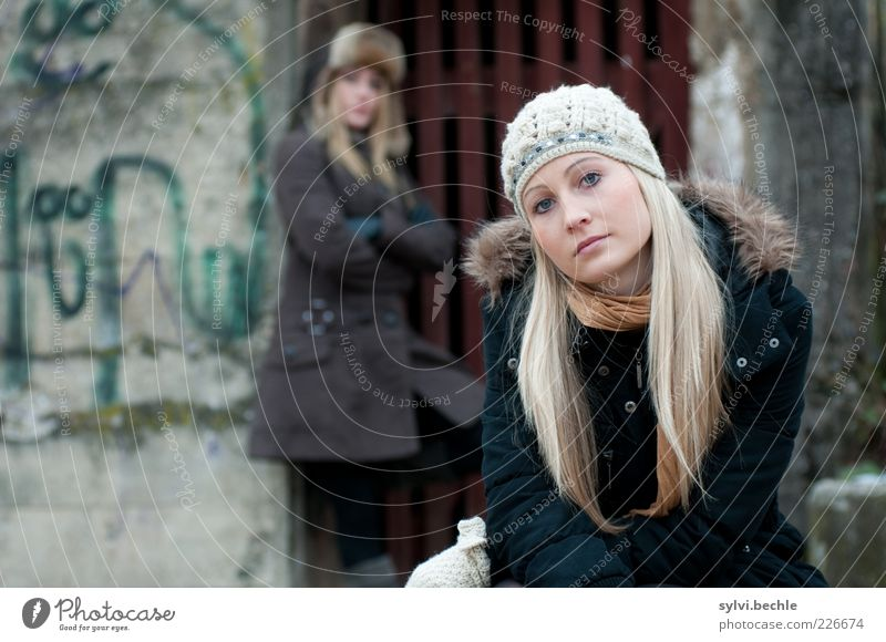 Human being Youth (Young adults) Beautiful Winter Face Relaxation Life Cold Feminine Wall (building) Wood Graffiti Hair and hairstyles Wall (barrier) Friendship Blonde