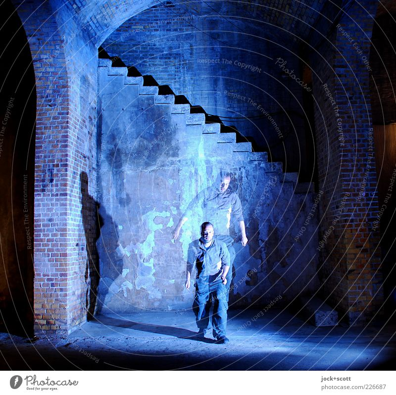 Moment in place Man Adults 1 Human being Manmade structures Storehouse Wall (building) Stairs Brick Movement To fall Jump Old Esthetic Blue
