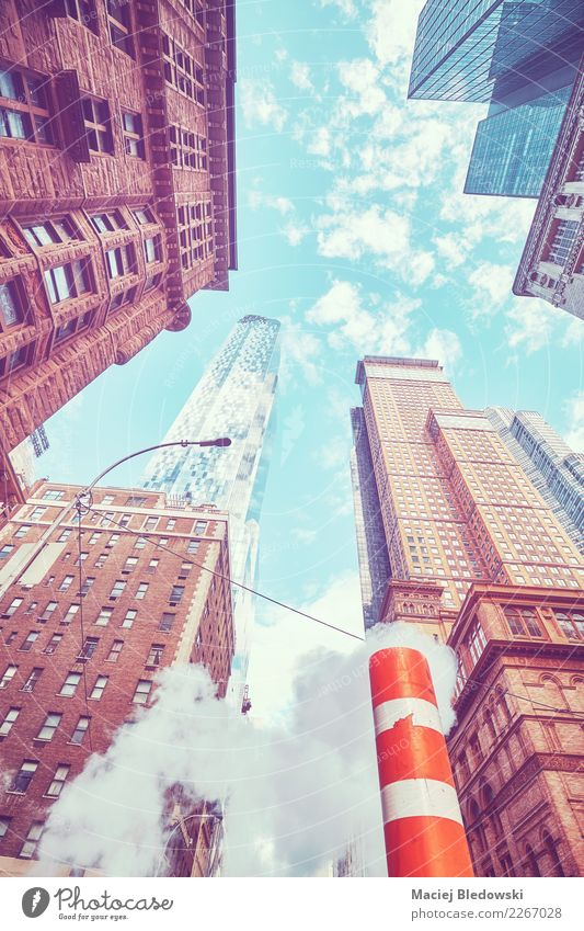 Looking up in New York City, color toned picture, USA. Sightseeing Flat (apartment) Office Town Downtown Skyline Populated House (Residential Structure)