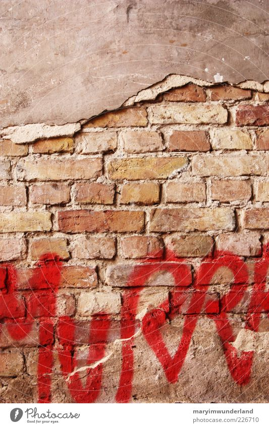 uncovered Facade Diet Red Graffiti Art Street art Wall (barrier) Brick Plaster Characters Letters (alphabet) Dye Deserted Brick wall Broken Capital letter Daub
