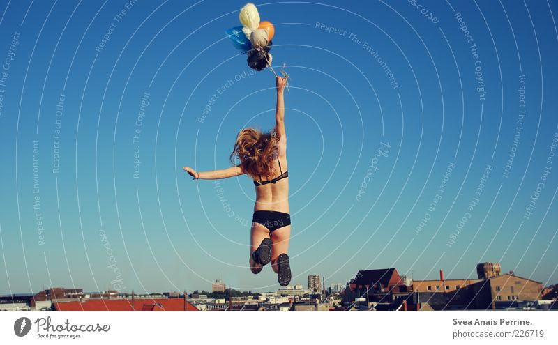 Human being Youth (Young adults) City Beautiful Summer House (Residential Structure) Adults Feminine Emotions Freedom Hair and hairstyles Jump Blonde Elegant Flying Exceptional