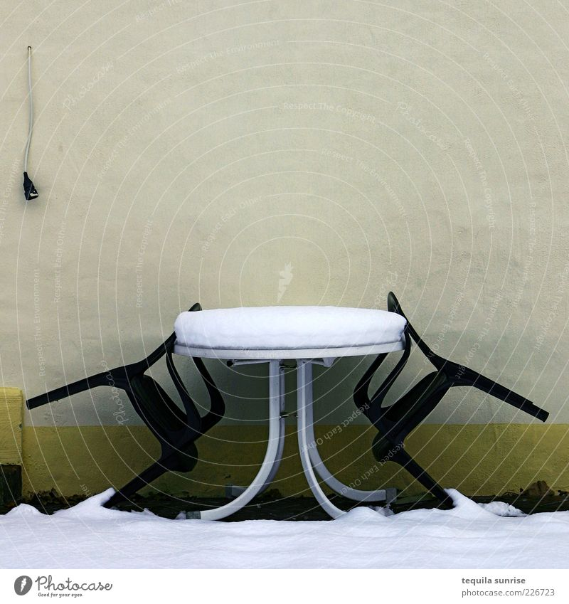 Waiting for summer Winter Weather Snow Garden Facade Terrace Chair Garden chair Table Garden table Wall (building) Cold Gloomy Yellow Green Colour photo
