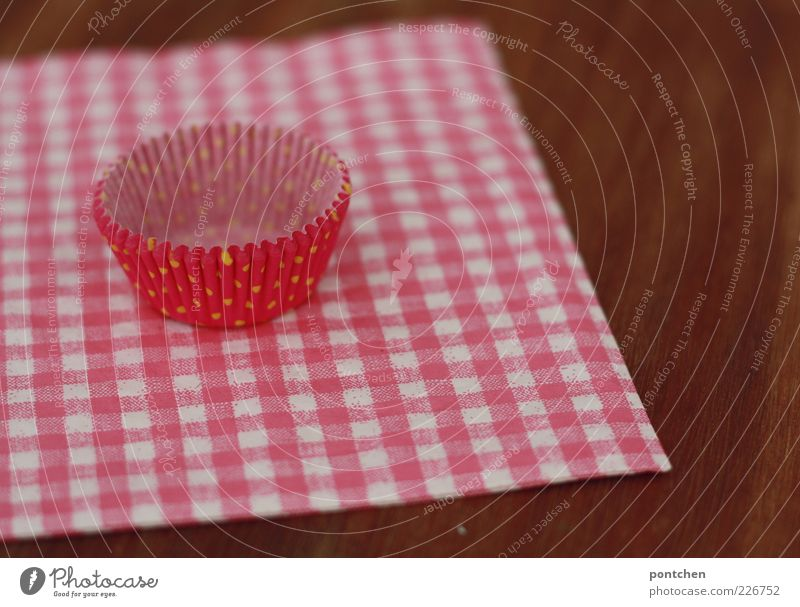 Pink cupcake shape made of paper lies on a pink and white checked napkin. Cute, cheesy. Decoration wood Napkin Checkered Muffin Paper Kitsch Reddish white