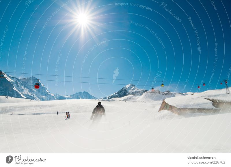 Sky Sun Joy Vacation & Travel Winter Snow Mountain Leisure and hobbies Tourism Climate Skiing Alps Switzerland Peak Beautiful weather Blue sky