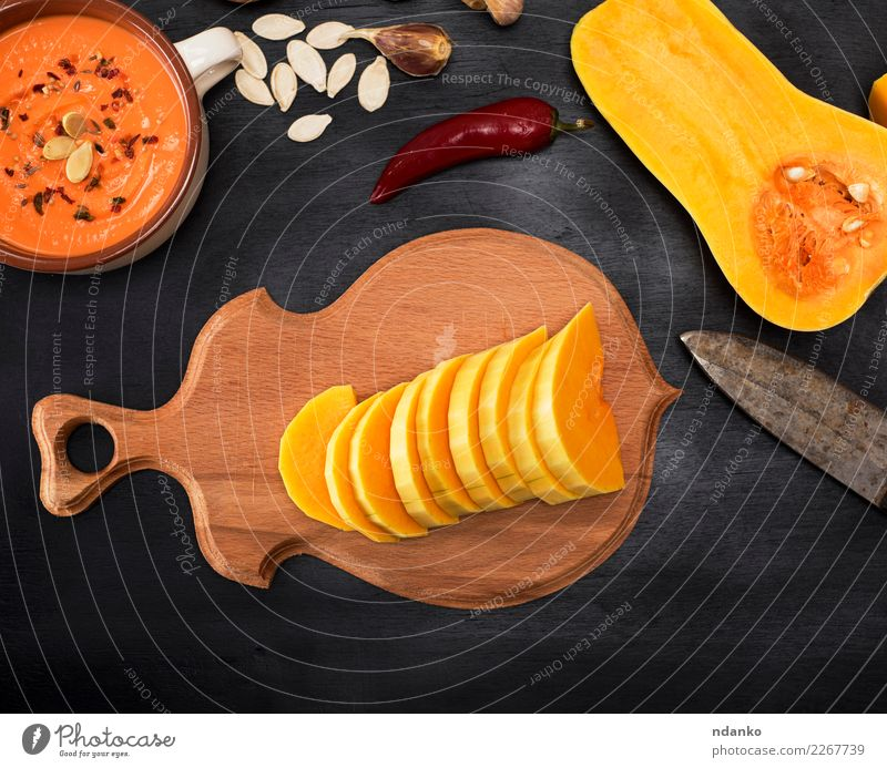fresh pumpkin is sliced into pieces Vegetable Soup Stew Herbs and spices Eating Lunch Dinner Vegetarian diet Bowl Decoration Table Hallowe'en Nature Autumn Wood
