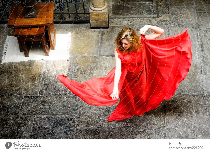 Beautiful blonde woman, wearing a red dress, dancing Elegant Happy Hair and hairstyles Face Make-up Relaxation Summer Human being Feminine Young woman
