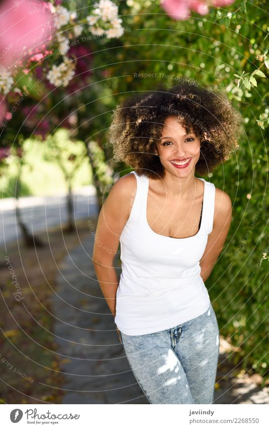 Young black woman with afro hairstyle smiling in urban park Woman Human being Youth (Young adults) Young woman Summer Beautiful Joy 18 - 30 years Adults
