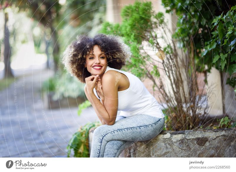 Young black woman with afro hairstyle smiling in urban park Woman Human being Youth (Young adults) Young woman Summer Beautiful Joy 18 - 30 years Street Adults