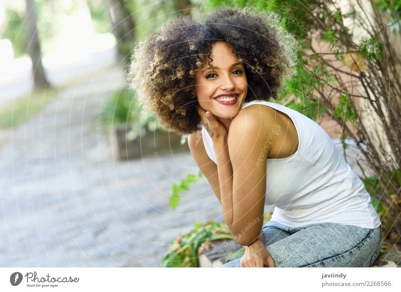 Mixed woman with afro hairstyle smiling in urban park Woman Human being Youth (Young adults) Young woman Beautiful Joy 18 - 30 years Face Street Adults