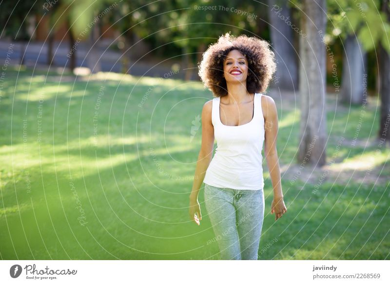 Mixed woman with afro hairstyle smiling in urban park Lifestyle Hair and hairstyles Summer Human being Feminine Young woman Youth (Young adults) Woman Adults 1