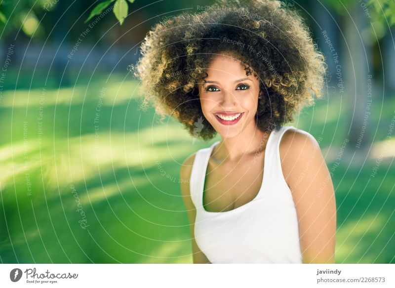 Black woman with afro hairstyle smiling in urban park. Woman Human being Youth (Young adults) Young woman Summer Beautiful Joy 18 - 30 years Face Street Adults