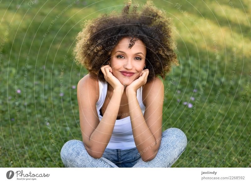 Mixed woman with afro hairstyle smiling in urban park Woman Human being Youth (Young adults) Young woman Summer Beautiful Joy 18 - 30 years Face Adults