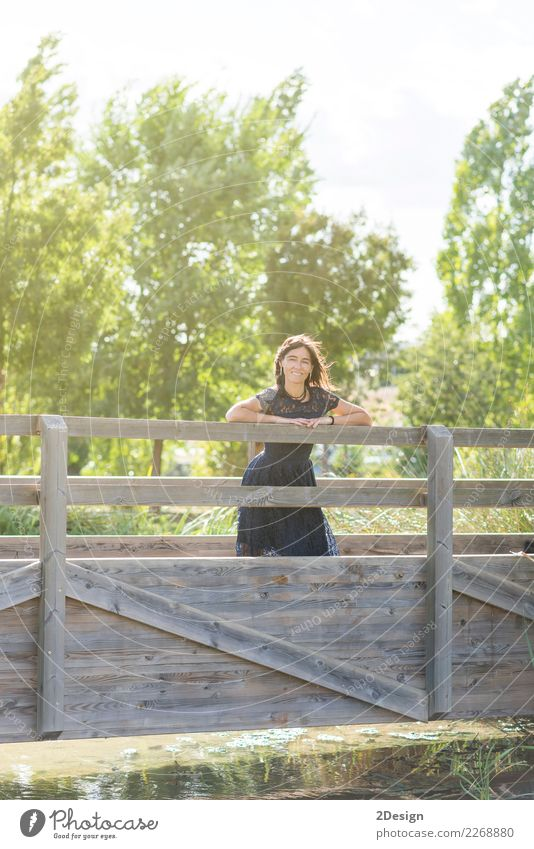 Portrait of a sensual woman on a wooden bridge Lifestyle Elegant Style Beautiful Vacation & Travel Summer Human being Woman Adults Nature Sky River Bridge