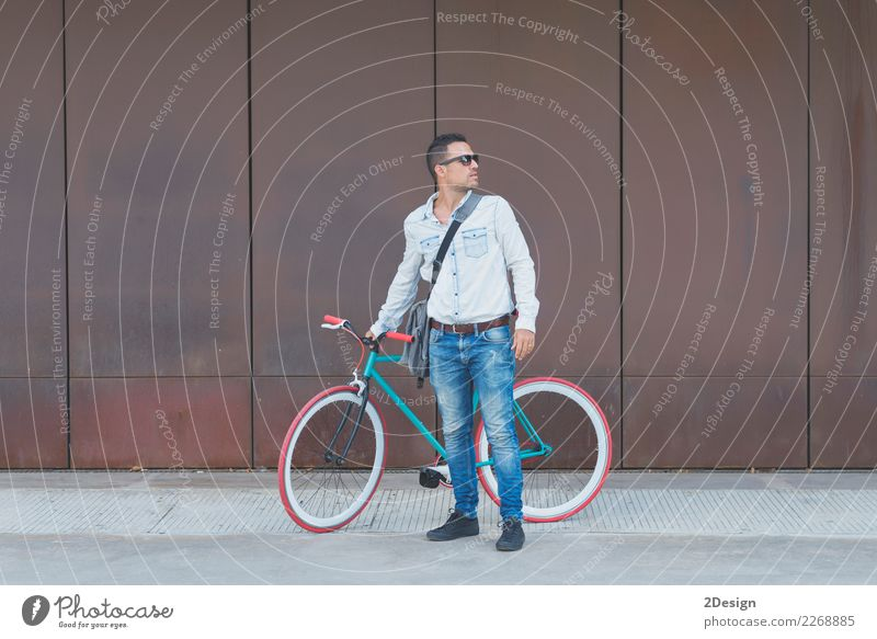 Stylish urban businessman standing on the street with bicycle Youth (Young adults) Man Relaxation Street Adults Lifestyle Sports Business Fashion Brown
