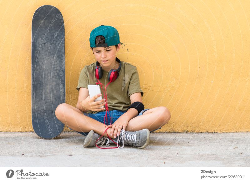 Portrait of a teenager sitting on the floor on a street Human being Youth (Young adults) Man Beautiful Hand Face Adults Life Lifestyle Boy (child) Freedom