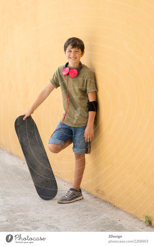 A Teen with skateboard on the city street Lifestyle Style Joy Happy Sports Schoolchild Human being Boy (child) Man Adults Infancy Street Fashion Jeans Smiling