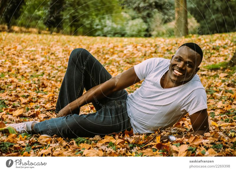 Park II. Contentment Vacation & Travel Human being Masculine Young man Youth (Young adults) Man Adults Culture Nature Autumn Leaf Jeans Lie Natural Tolerant