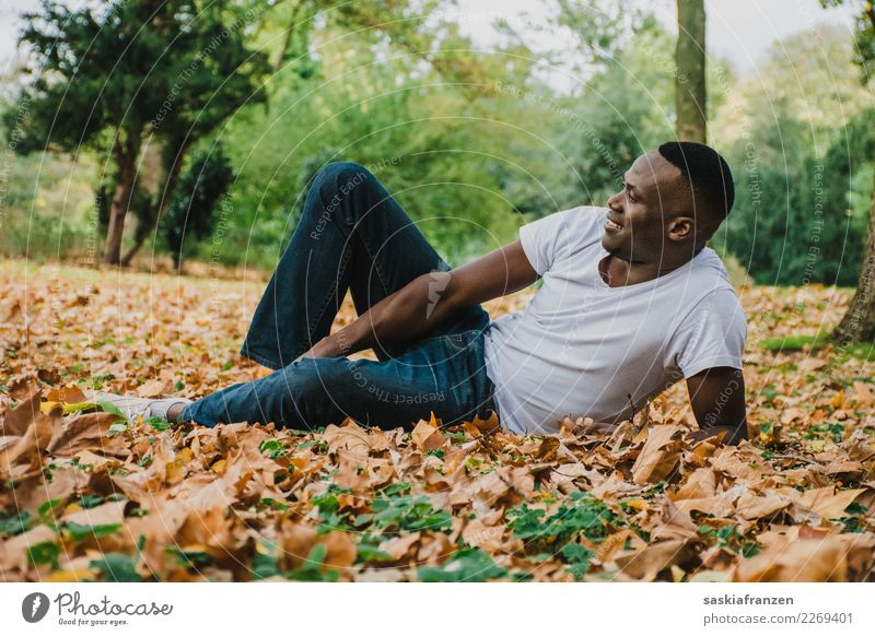 Human being Nature Vacation & Travel Man Young man Leaf Travel photography Autumn Natural Contentment Masculine Park Lie Culture Model Jeans