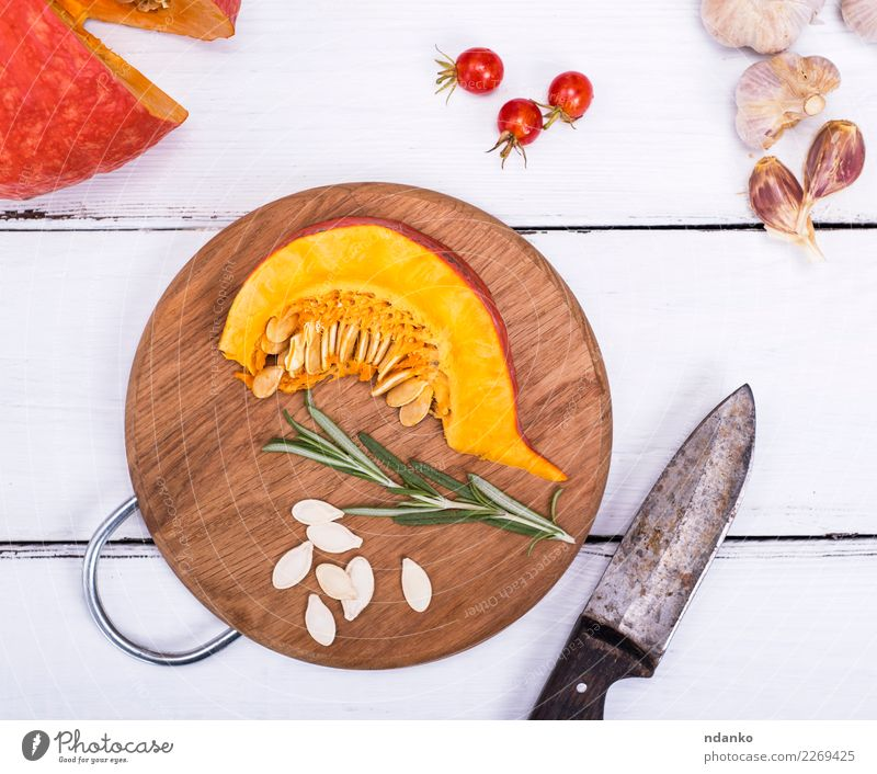 fresh slices of pumpkin Vegetable Herbs and spices Nutrition Eating Lunch Dinner Vegetarian diet Diet Knives Decoration Table Kitchen Hallowe'en Nature Autumn