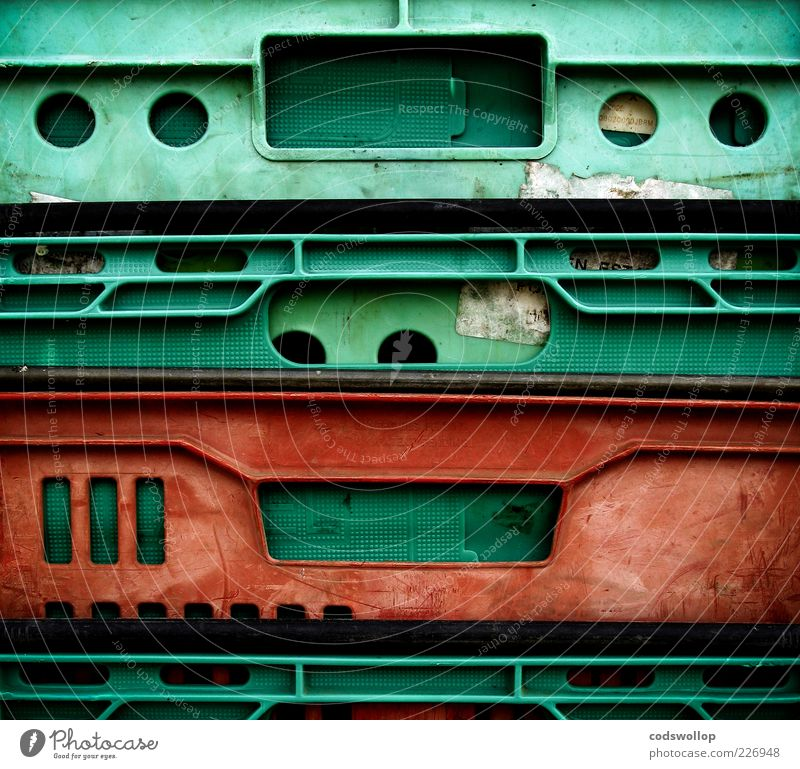 breadbox monkey Plastic Old Green Red Geometry Second-hand Colour photo Abstract Structures and shapes Contrast Plastic packaging Plastic box Plastic world