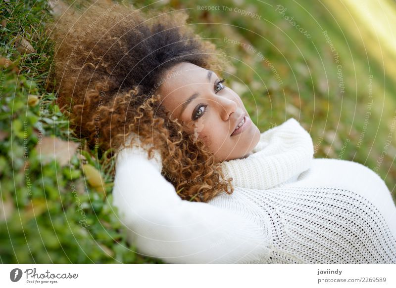 Young African American woman lying on grass Lifestyle Beautiful Hair and hairstyles Face Human being Feminine Young woman Youth (Young adults) Woman Adults Head