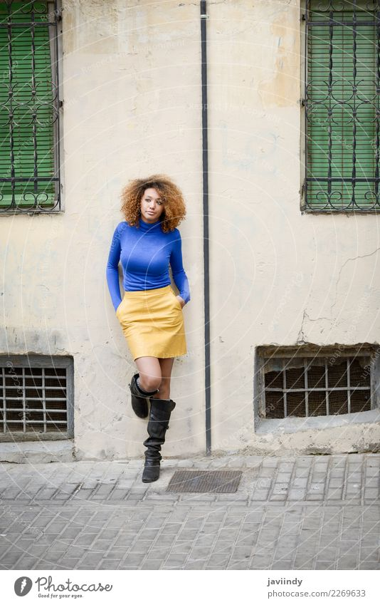 Afroamerican woman in urban street. Afro hairstyle. Lifestyle Elegant Style Beautiful Hair and hairstyles Face Human being Feminine Young woman