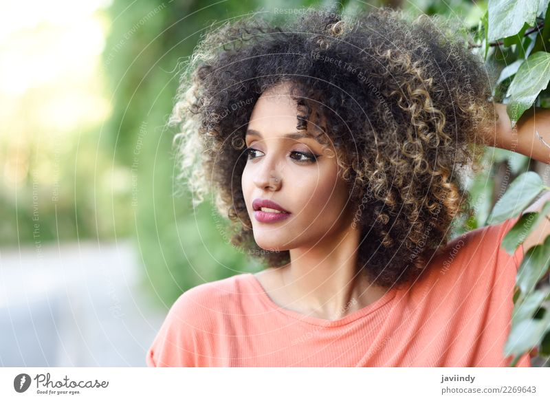 Young beautiful woman with afro hairstyle, outdoors Lifestyle Style Beautiful Hair and hairstyles Face Human being Young woman Youth (Young adults) Woman Adults