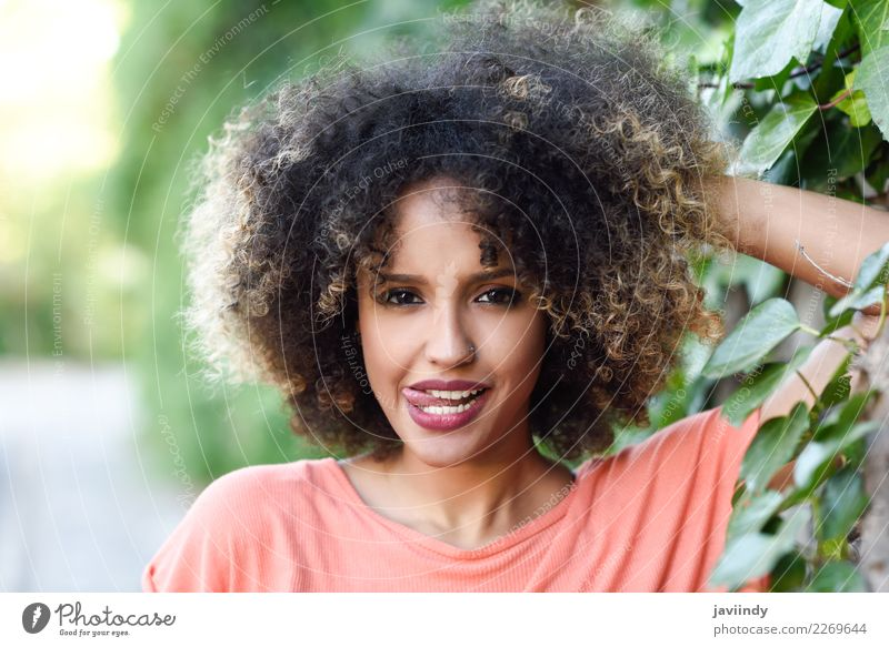 Black woman with tongue out in an urban park Lifestyle Style Joy Happy Beautiful Hair and hairstyles Face Human being Feminine Young woman Youth (Young adults)