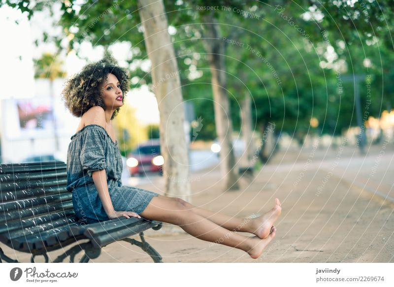 Barefoot black woman with afro hairstyle sitting on a bench Lifestyle Style Beautiful Hair and hairstyles Human being Feminine Young woman Youth (Young adults)