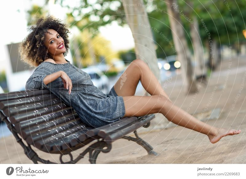 Young black woman with afro hairstyle sitting on a bench Woman Human being Youth (Young adults) Young woman Beautiful Joy Black Face Street Adults Lifestyle