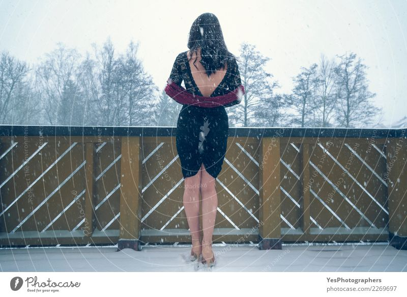Sexy woman in black dress under snowfall Elegant New Year's Eve Young woman Youth (Young adults) Nature Snowfall High heels Think Sadness Loneliness