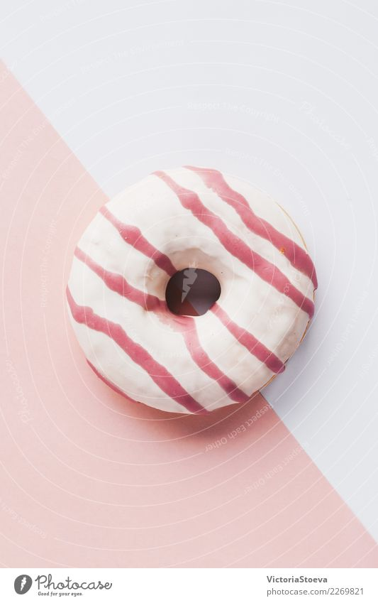 Top view of pink donut on white and pink background Food Dough Baked goods Cake Dessert Breakfast Decoration Feasts & Celebrations Movement Pink White Colour