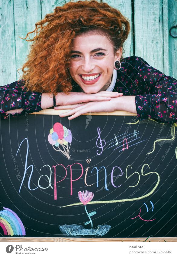 Young happy redhead woman with a blackboard Lifestyle Style Joy Beautiful Hair and hairstyles Skin Face Blackboard Human being Feminine Young woman