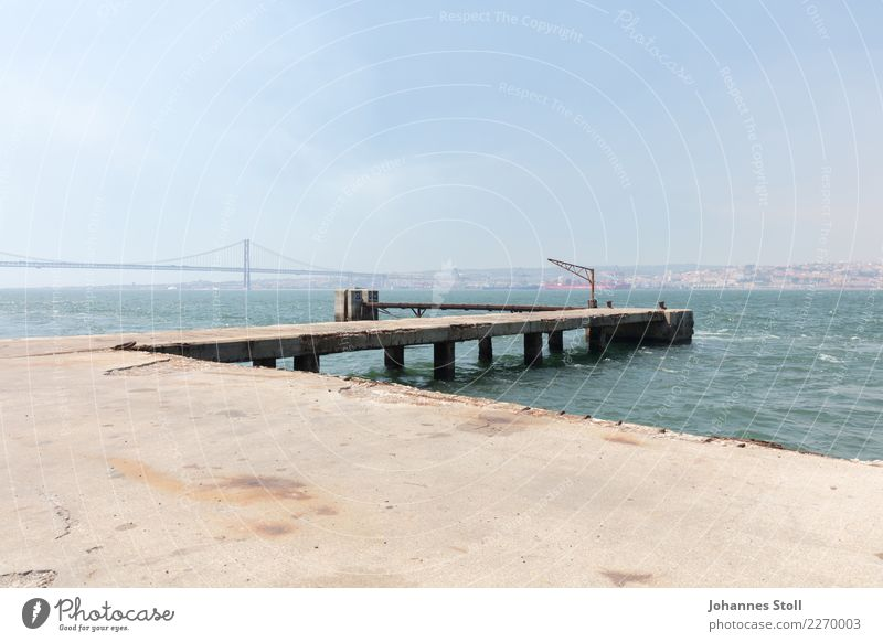 View from Cacilhas docks over river Tejo on old town Lisbon Water Sky Summer River bank Capital city Outskirts Harbour Manmade structures Landmark Bridge