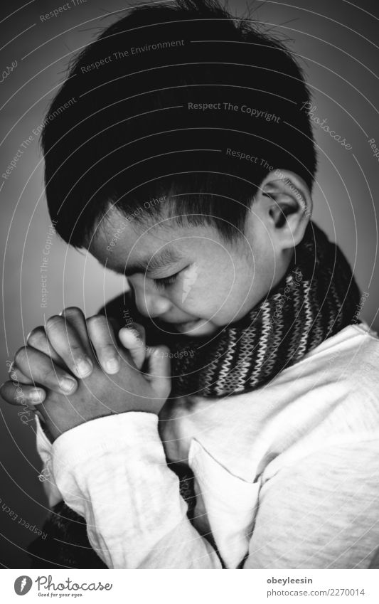 Closeup on a young boy pray, believe concept Lifestyle Reading Human being Man Adults Father Hand Fingers Book Library Church Suit Tie Paper Dark Black Hope