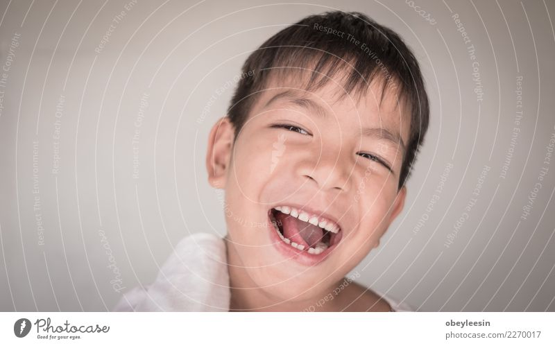 Close up face portrait little young asian boy Child Man Blue Beautiful White Joy Face Adults Funny Emotions Style Laughter Boy (child) Small Happy Gray