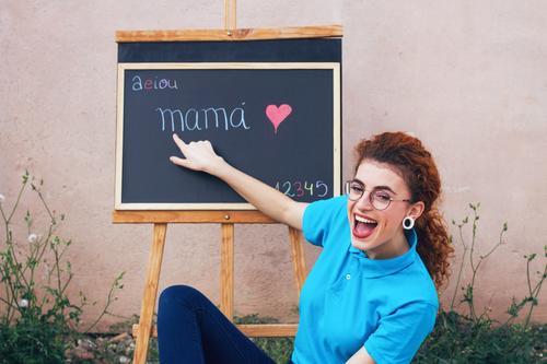 Young teacher in a school lesson Lifestyle Joy Beautiful Parenting Education Kindergarten School Classroom Blackboard Teacher Work and employment Profession