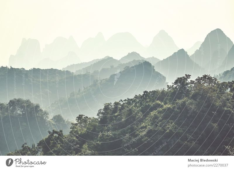 Karst mountains on a foggy day, Guilin, China. Vacation & Travel Adventure Expedition Camping Mountain Nature Landscape Fog Forest Hill Beautiful Green Freedom
