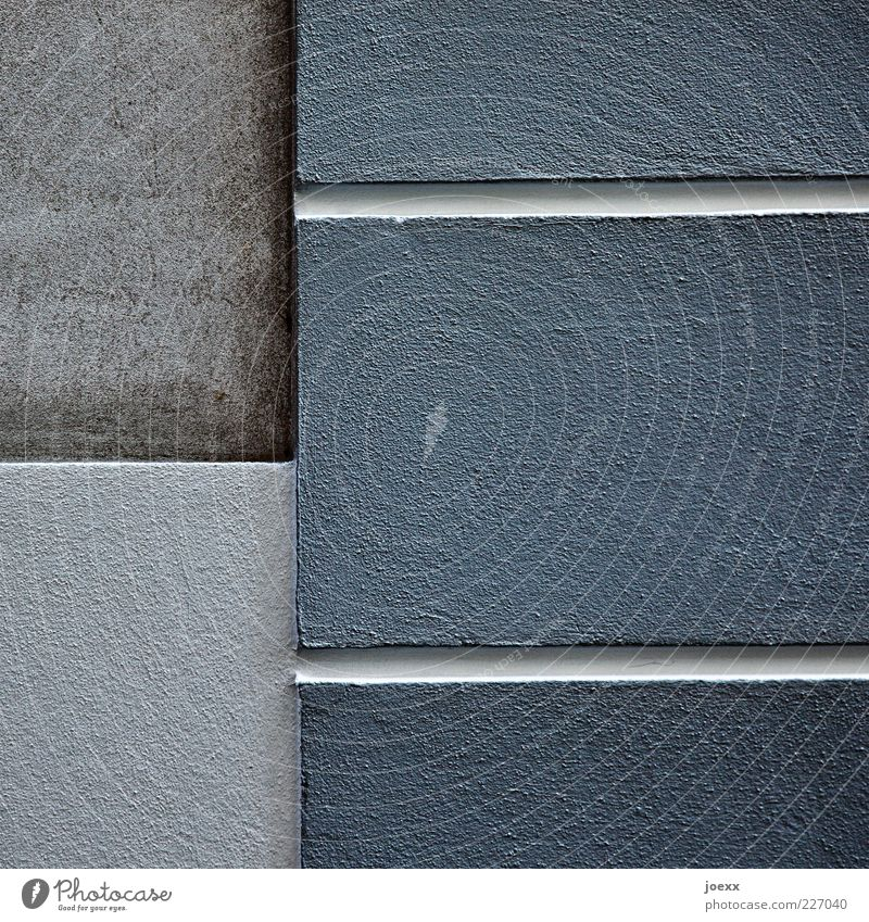 - | = Wall (barrier) Wall (building) Facade Sharp-edged Blue Gray Plaster Line Colour photo Subdued colour Exterior shot Detail Day Seam Deserted Copy Space