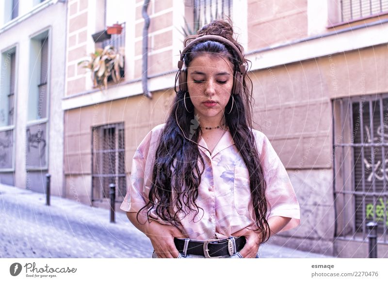 teenager listening to music on the street Youth (Young adults) Young woman Beautiful Calm Lifestyle Emotions Feminine Art Fashion Feasts & Celebrations Pink