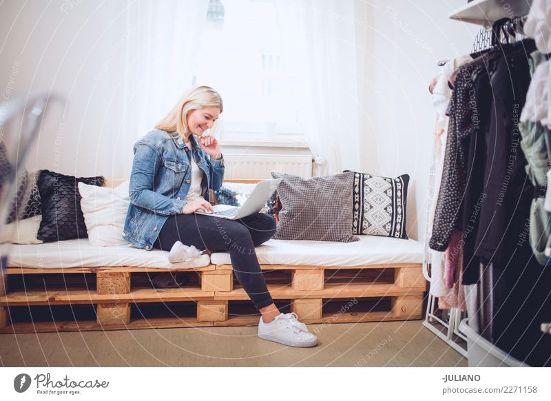 Young woman sitting on diy couch with notebook Lifestyle Shopping Living or residing Flat (apartment) Interior design Room Living room Human being Feminine