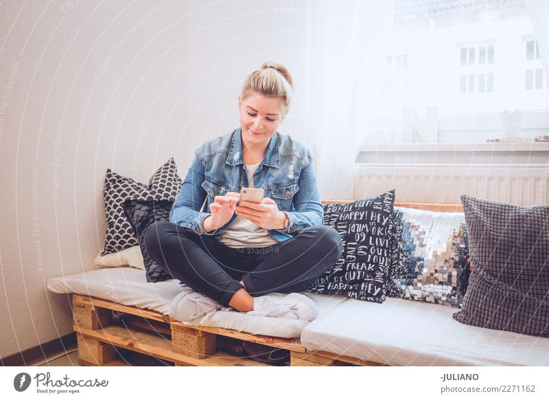 young woman sitting on her diy couch with phone Lifestyle Shopping Vacation & Travel Living or residing Flat (apartment) Interior design Room Living room